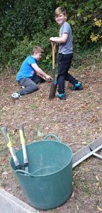 Sam and Charlie Jones planting bulbs